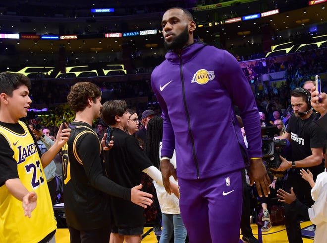 LeBron James takes the court for warm-ups before the Lakers' home opener.
