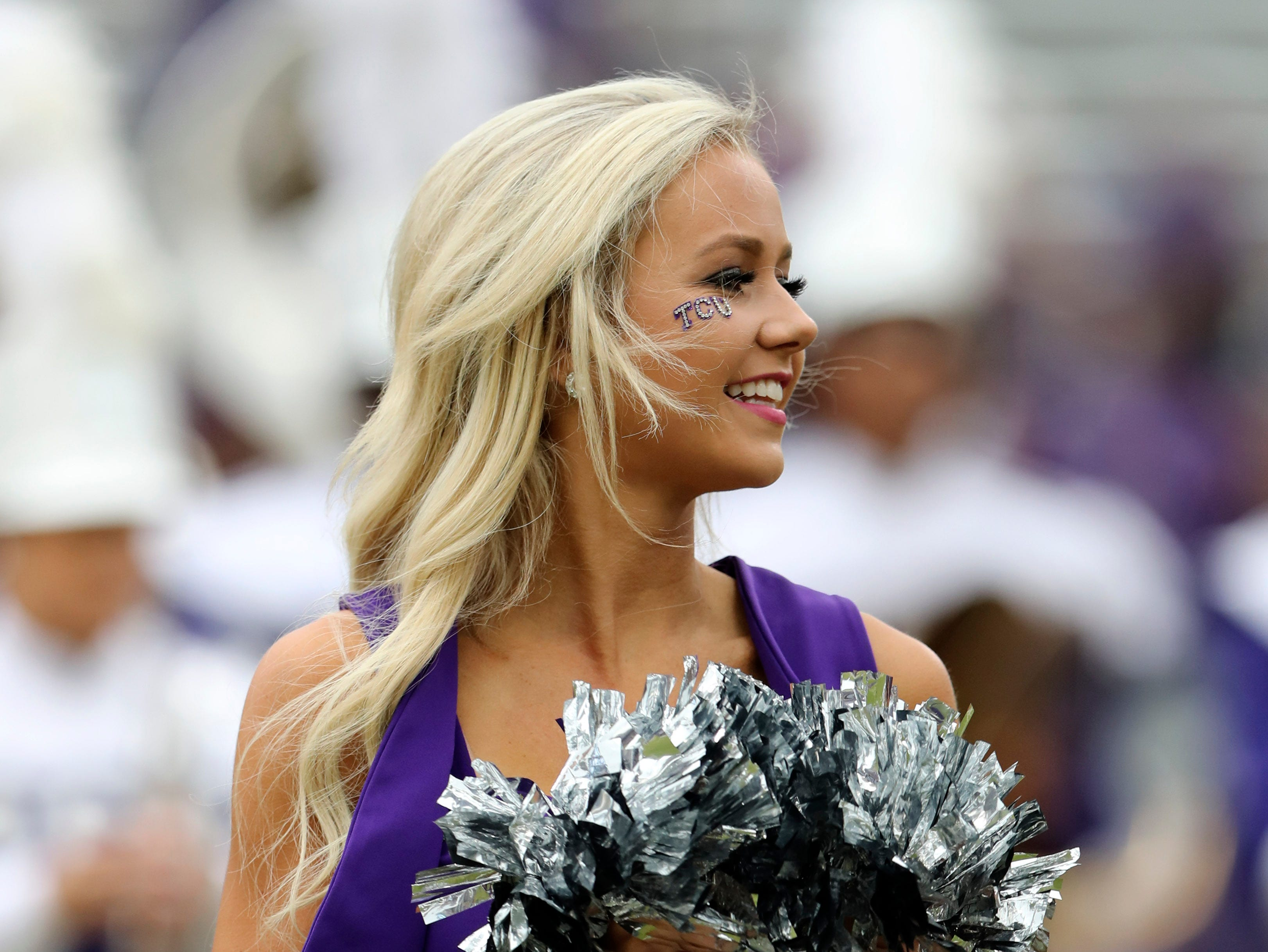 A TCU Horned Frogs cheerleader performs before the game against the Oklahoma Sooners at Amon G. Carter Stadium.