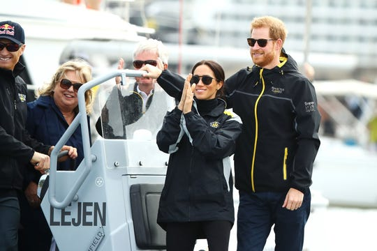 Duchess Meghan and Prince Harry watch the Elliott 7 Team racing during the Sailing on Day 2 of the Invictus Games Sydney 2018 on Sydney Harbour on Oct. 21, 2018.