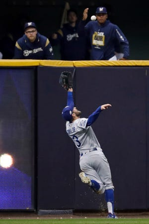 Chris Taylor tracks down the fly ball  hit by Christian Yelich. It was the catch of the game, and the NLCS.