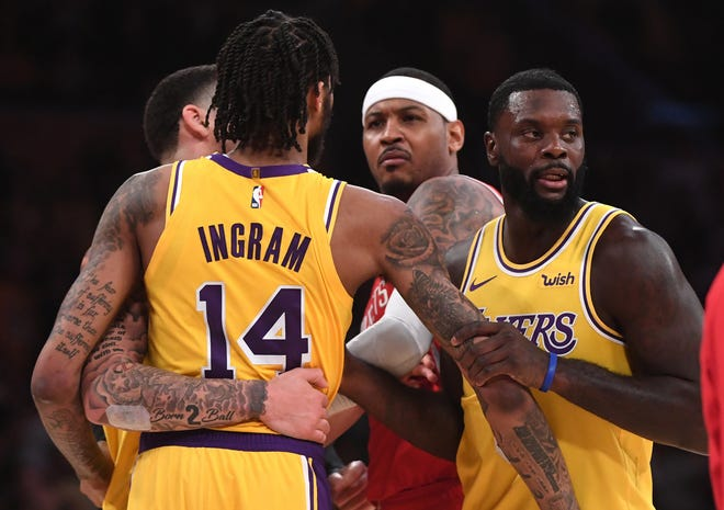 Lakers Lance Stephenson (right) and  Lonzo Ball (left) restrain Brandon Ingram as he exchanges words with Rockets Carmelo Anthony (7) after a fight in the fourth quarter of the game at Staples Center.