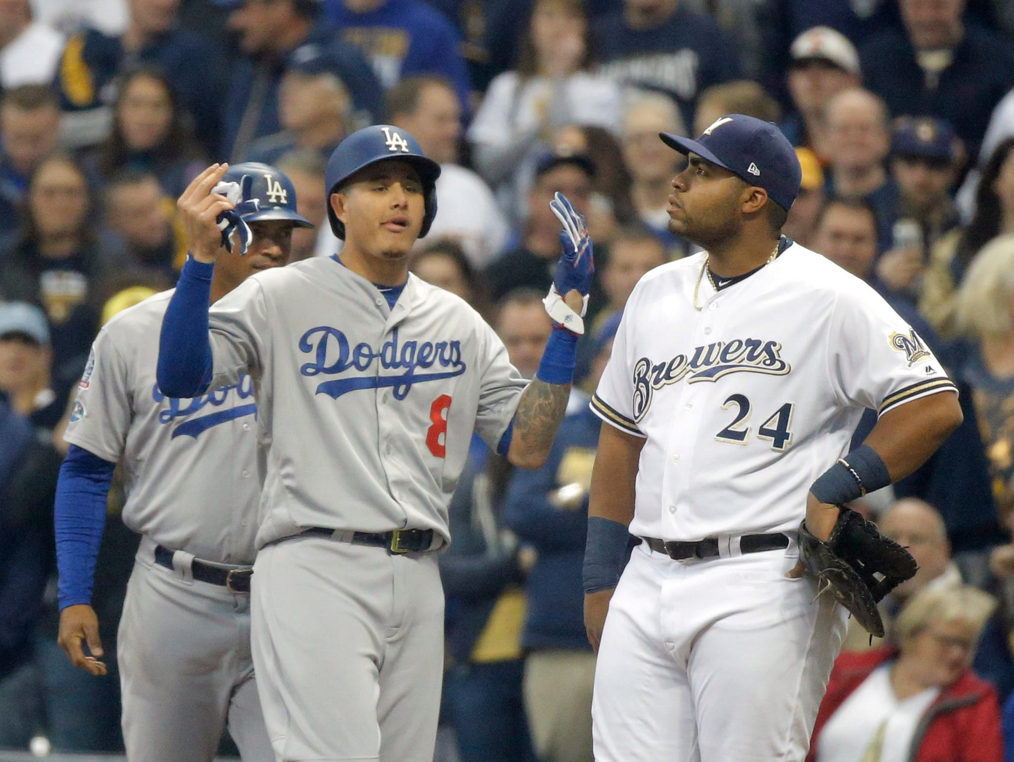 NLCS Game 7: Manny Machado reacts after a bunt single in the second inning.