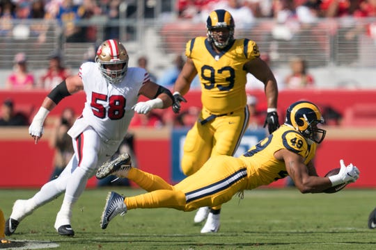Los Angeles Rams linebacker Trevon Young (49) gets his hands on a fumble by San Francisco 49ers quarterback C.J. Beathard during the first quarter at Levi's Stadium.