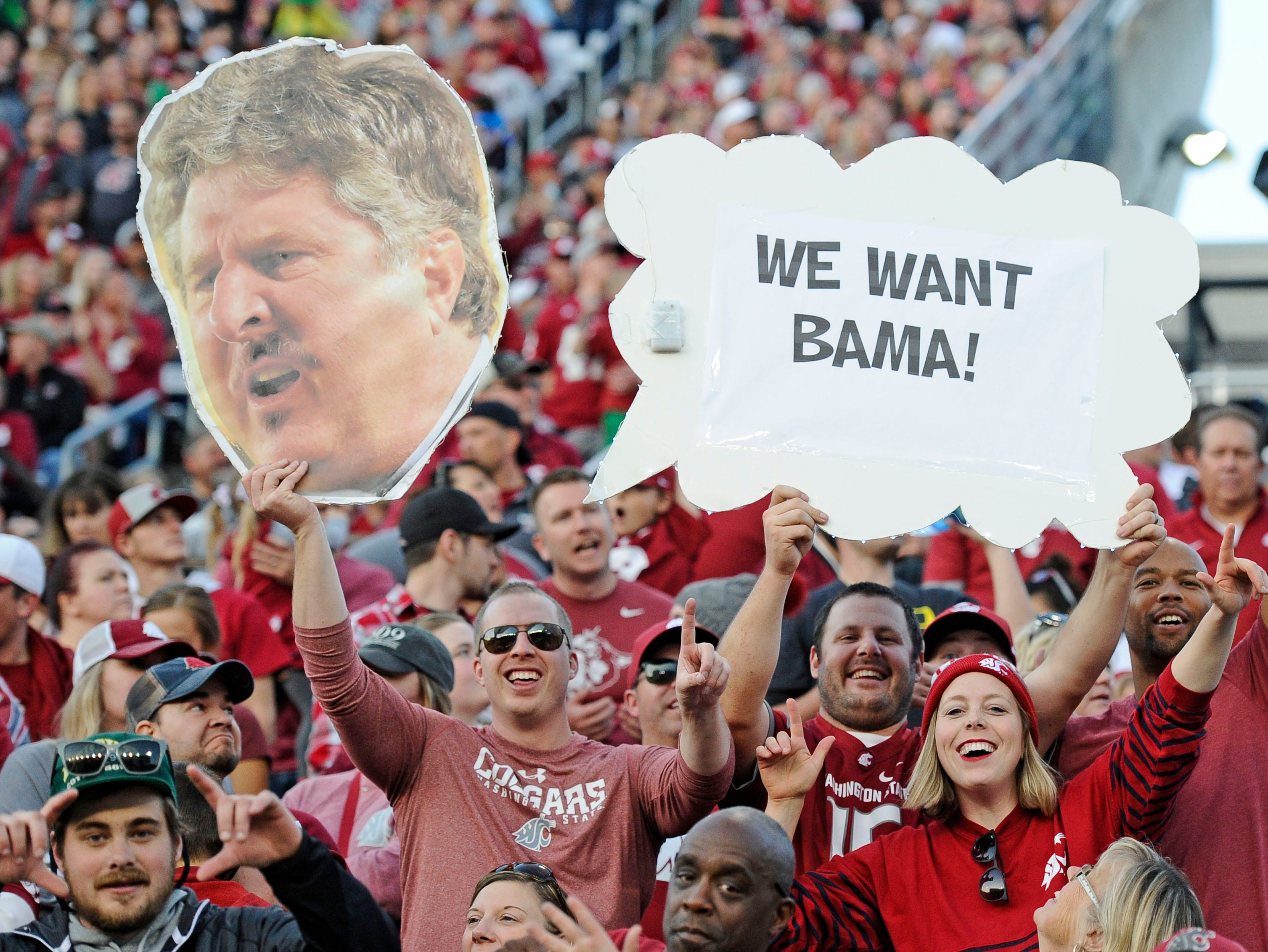 Week 8: Washington State Cougars fans hold up signs during a football game against the Oregon Ducks at Martin Stadium.