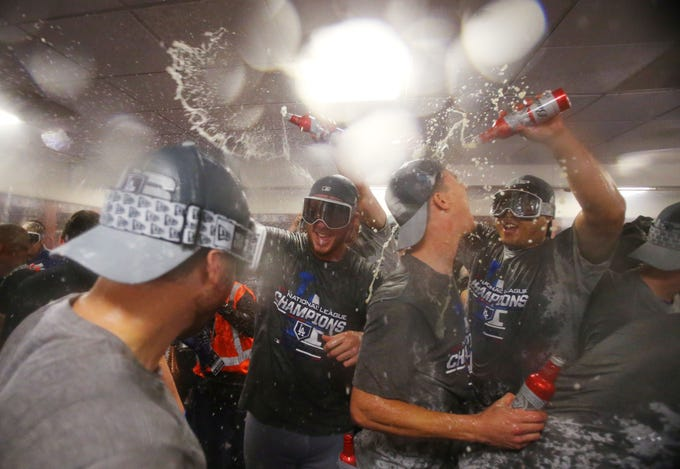 NLCS Game 7: Dodgers players celebrate in the clubhouse.