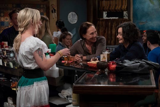 Becky (Lecy Goranson), left, Jackie (Laurie Metcalf) and Darlene (Sara Gilbert) enjoy a moment together at Casa Bonita in Tuesday's episode of 'The Conners.'