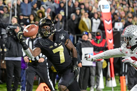 Purdue Boilermakers receiver Isaac Zico (7) makes a one-handed catch for a touchdown against the Ohio State Buckeyes at Ross-Ade Stadium.