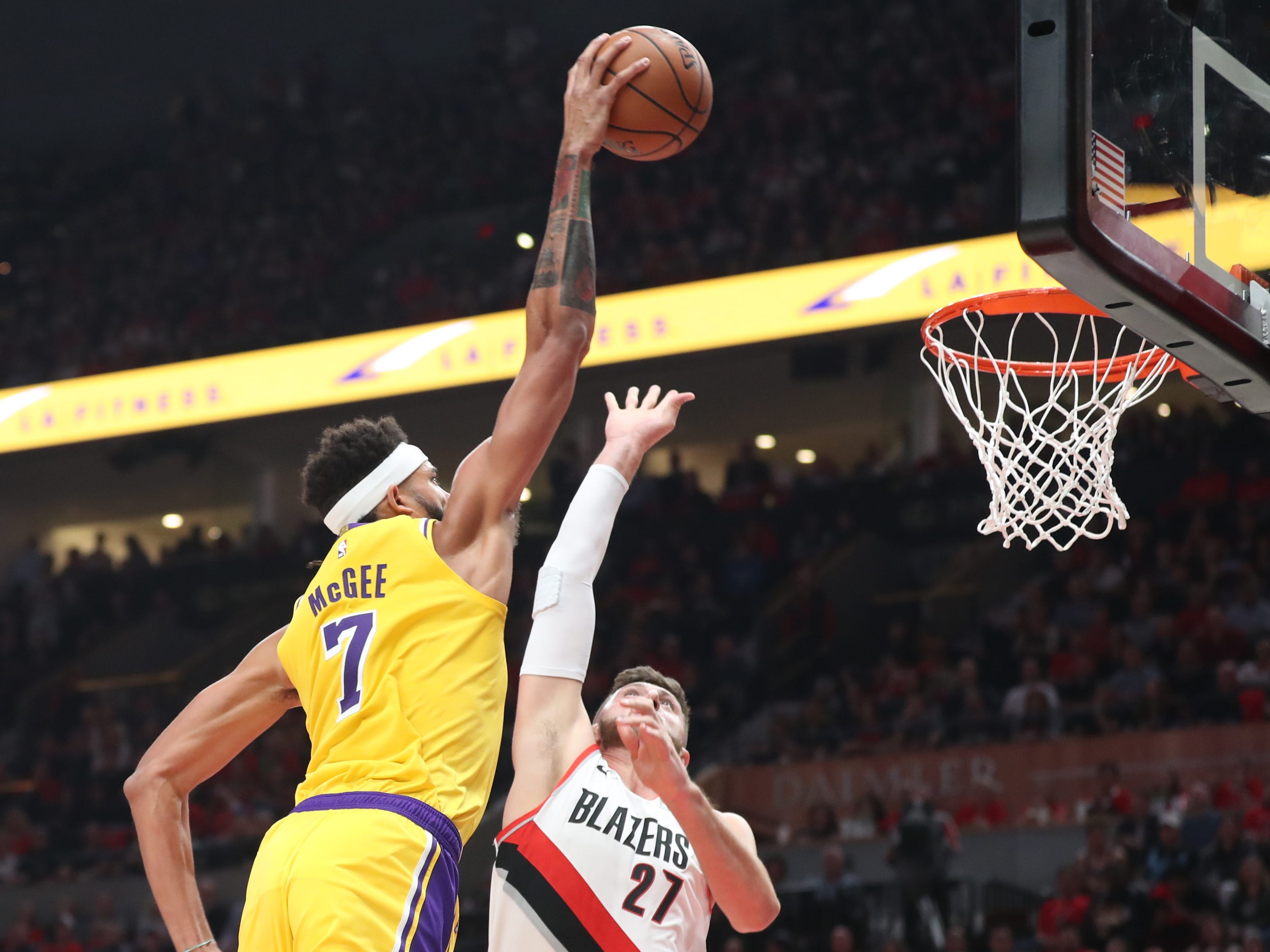 Oct. 18: Los Angeles Lakers center JaVale McGee dunks over Portland Trail Blazers center Jusuf Nurkic at Moda Center.