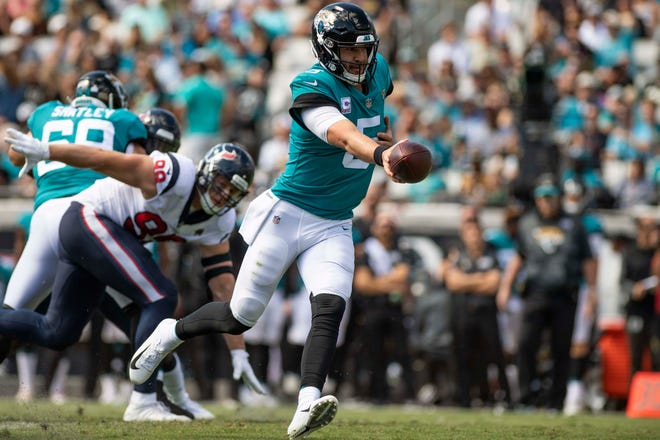 Jacksonville Jaguars quarterback Blake Bortles (5) looks to hand off the ball during the first quarter against the Houston Texans at TIAA Bank Field.