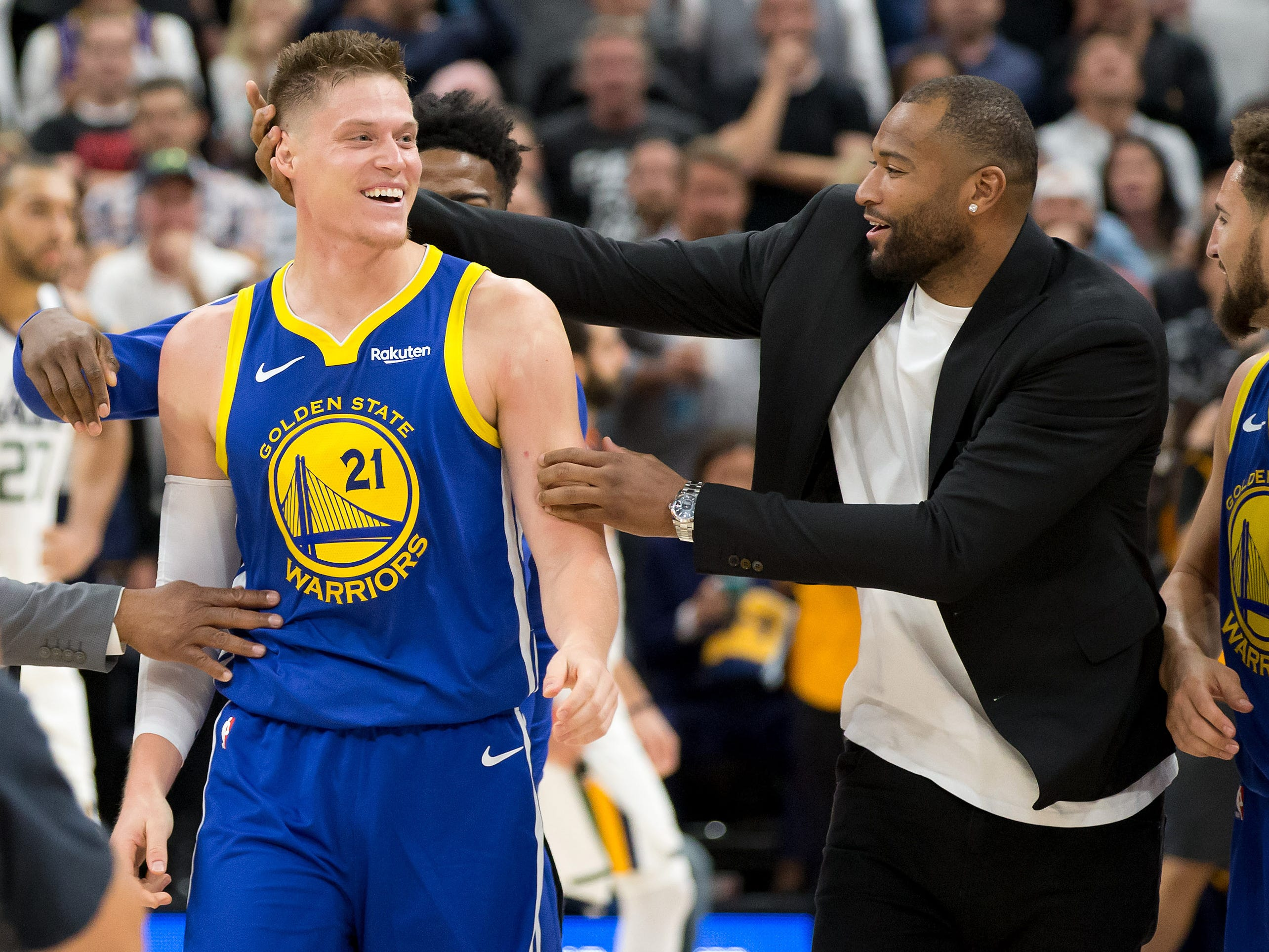 Oct. 19: Warriors forward Jonas Jerebko celebrates with injured center DeMarcus Cousins after his game-winning tip-in at the buzzer beat the Jazz in Salt Lake City.