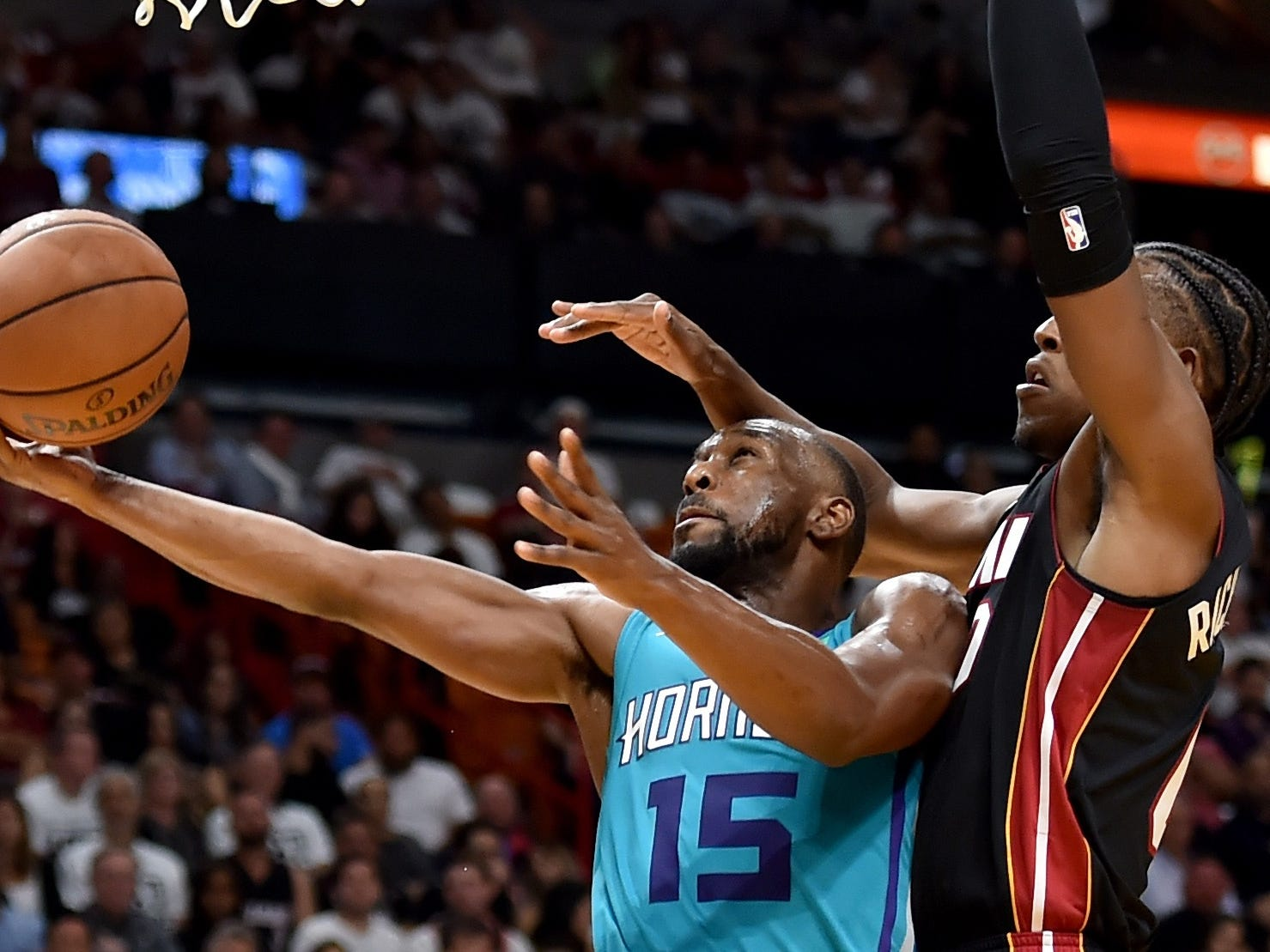 Oct. 20: Hornets guard Kemba Walker (15) drives to the hoop against Heat forward Josh Richardson (0).