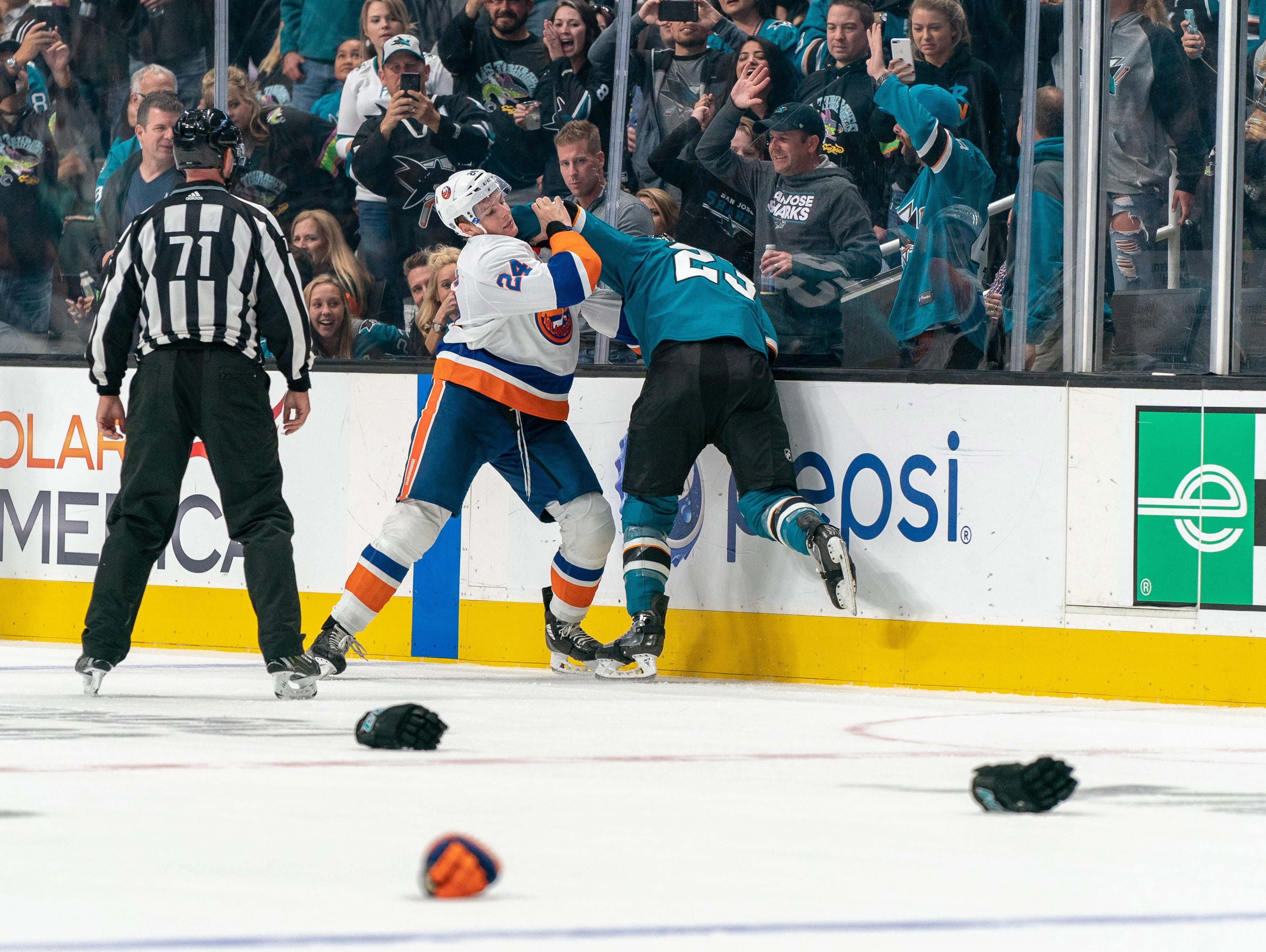 Oct. 20: New York Islanders' Scott Mayfield (24) vs. San Jose Sharks' Barclay Goodrow.