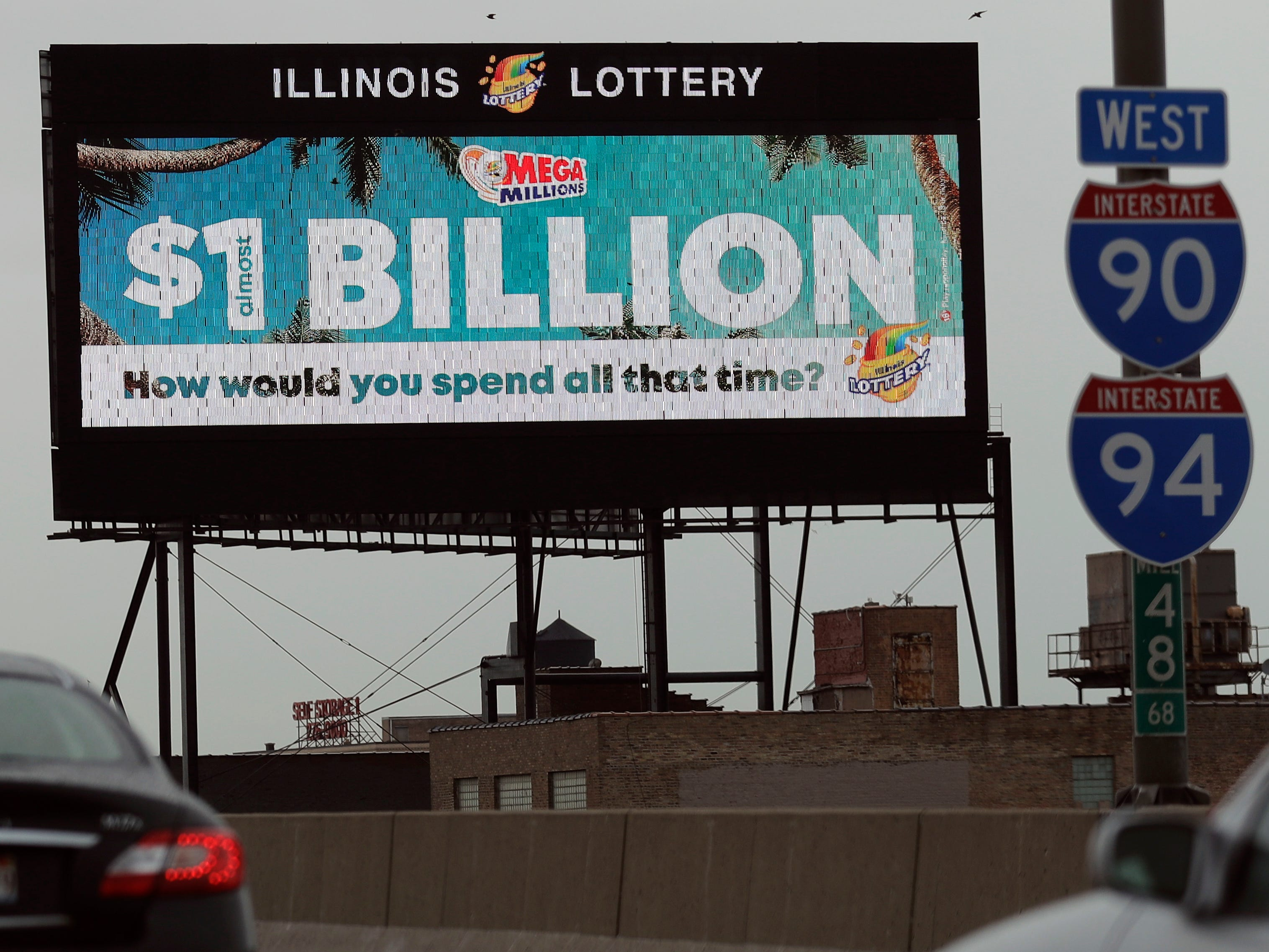 A digital billboard along I-90/94 highway in Chicago, displays the estimated Mega Millions jackpot, Friday, Oct. 19, 2018.