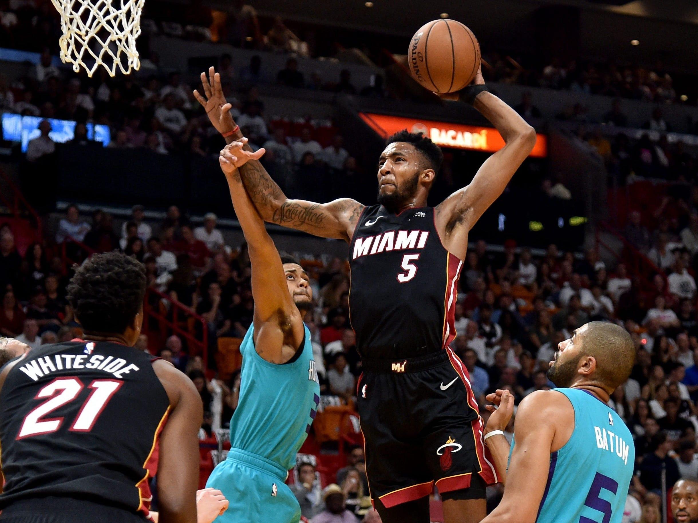 Oct. 20: Heat forward Derrick Jones Jr. (5) soars to the bucket for the lefty slam against the Hornets.