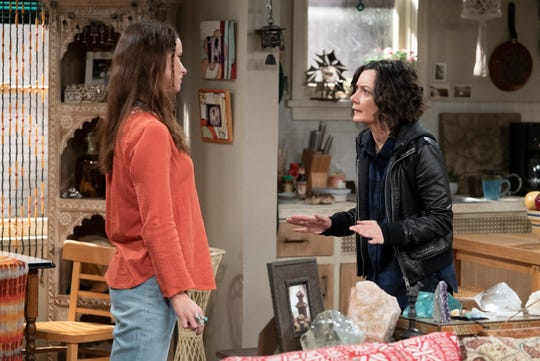 Darlene (Sara Gilbert), right, takes issue with Blue (Juliette Lewis), the girlfriend of estranged husband David, on Tuesday's episode of ABC's 'The Conners.'
