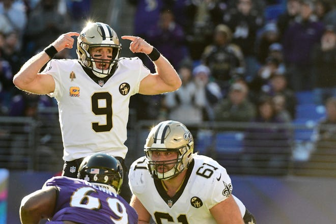 New Orleans Saints quarterback Drew Brees (9) changes the play at the line during the first quarter against the Baltimore Ravens at M&T Bank Stadium.