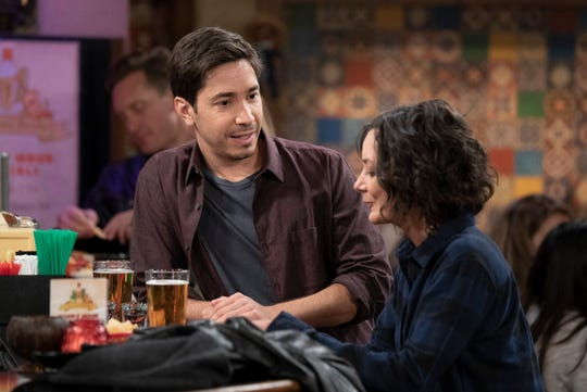 A potential suitor (Justin Long), left, talks to Darlene (Sara Gilbert) at Casa Bonita during Tuesday's episode of ABC's 'The Conners.'