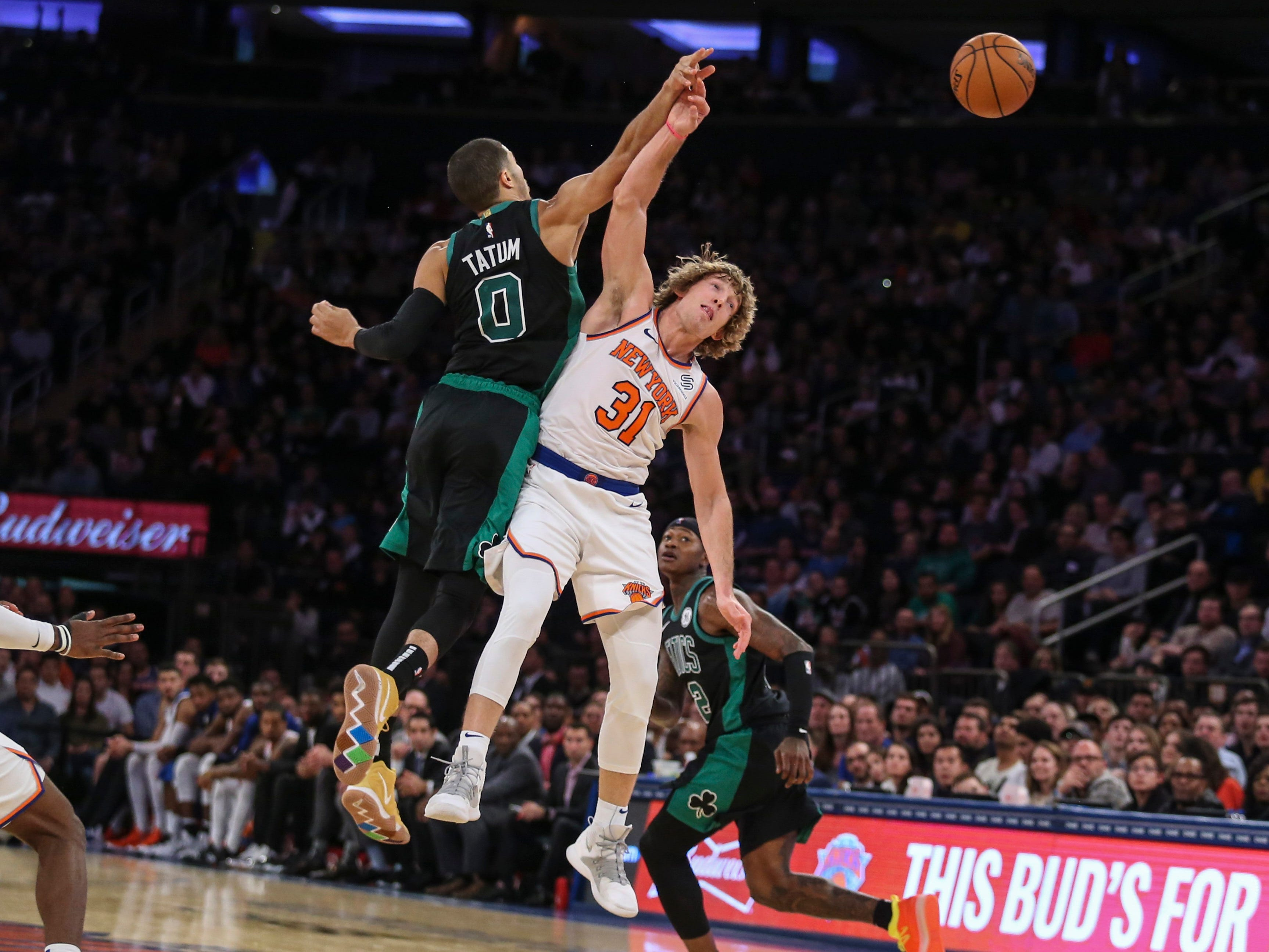 Oct. 20: Celtics forward Jayson Tatum (0) collides with Knicks guard Ron Baker (31) while chasing after a loose ball.