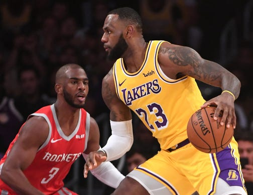 6540364c0cf Oct. 20: Lakers forward LeBron James (23) looks for room to work
