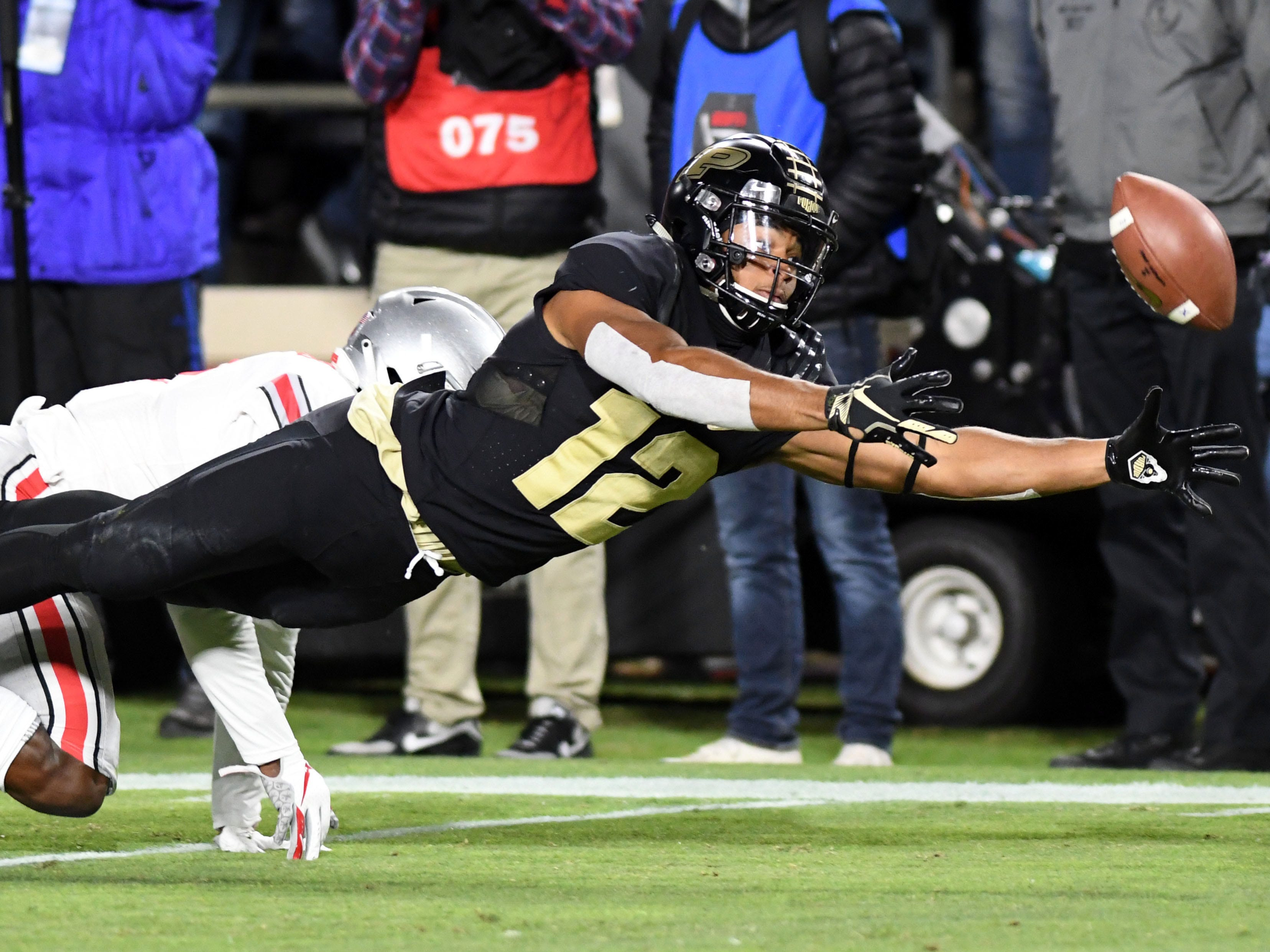 Purdue Boilermakers receiver Jared Sparks (12) dives for a pass in the first half against the Ohio State Buckeyes at Ross-Ade Stadium.