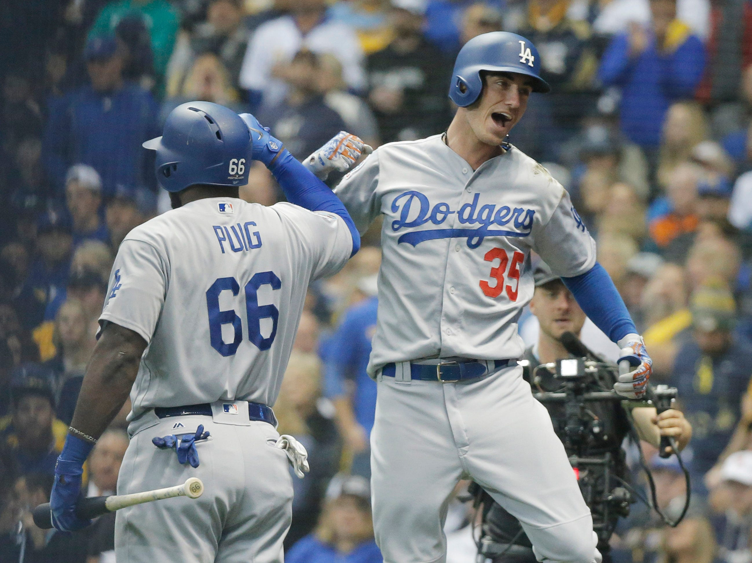 NLCS Game 7: Cody Bellinger celebrates his home run in the second inning with Yasiel Puig.