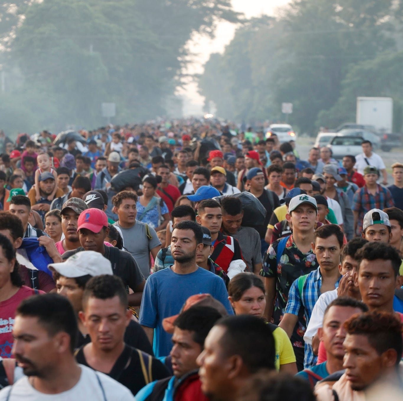 Central American migrants walking to the U.S. start their day departing Ciudad Hidalgo, Mexico, Sunday, Oct. 21, 2018.