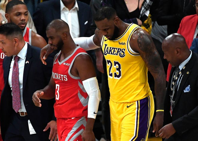 LeBron James helped restrain his good friend Chris Paul during the chaotic Lakers-Rockets brawl.