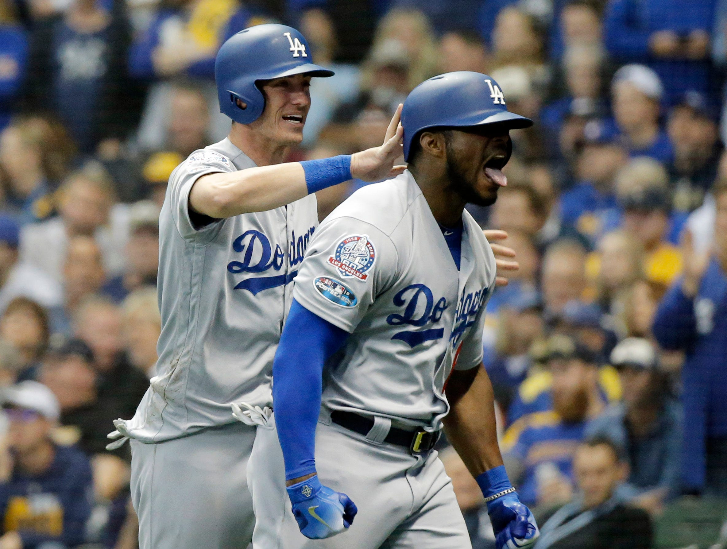 NLCS Game 7: Yasiel Puig celebrates his three-run home run in the sixth inning..