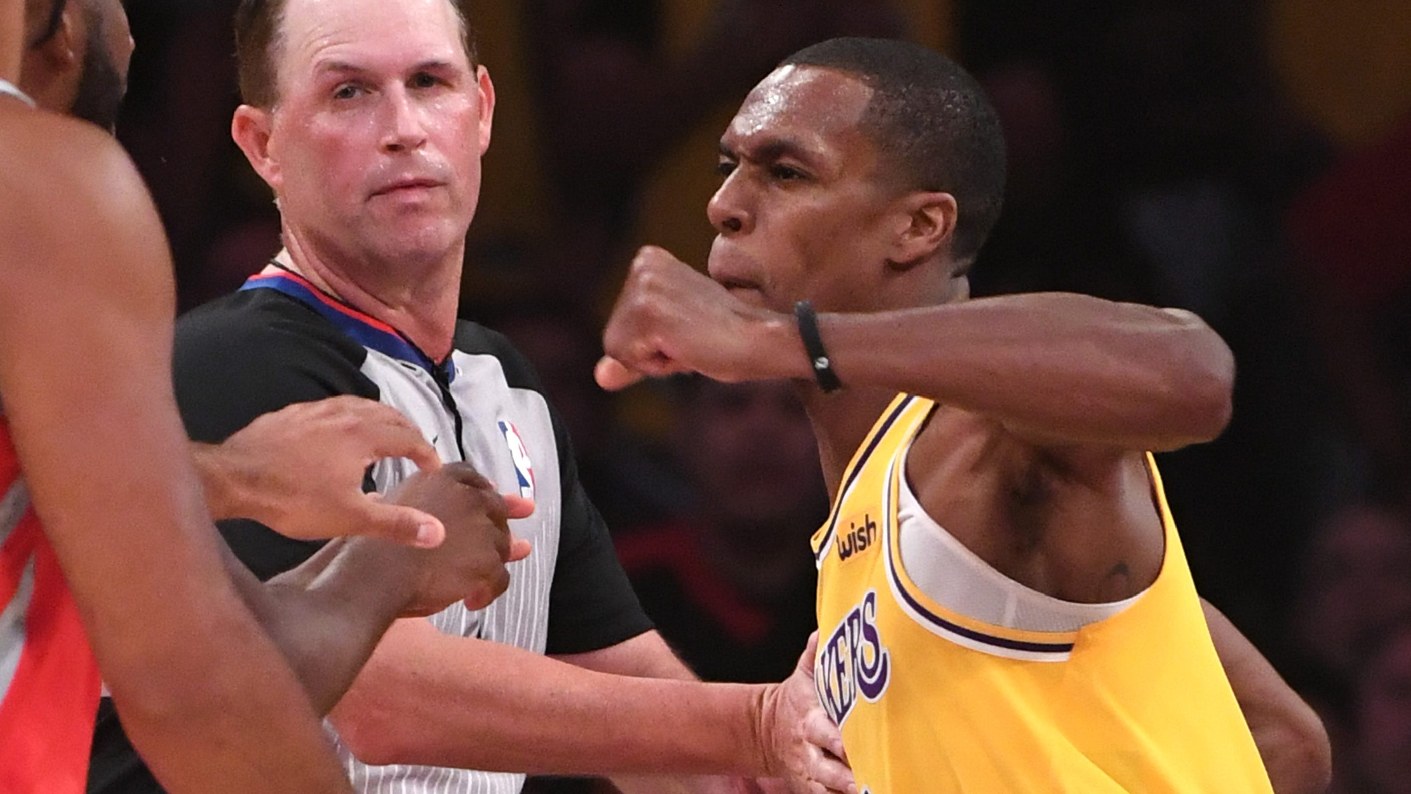 Rajon Rondo throws a punch at Chris Paul during the chaotic scene.