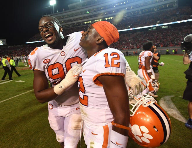 Clemson defensive back K'Von Wallace (12), right, celebrates with defensive lineman Clelin Ferrell (99) after the Tigers 38-31 win over NC State on Saturday, Nov. 28, 2017 at Clemson's Memorial Stadium. Wallace intercepted an NC State pass in the closing seconds of the 4th quarter to seal the win.