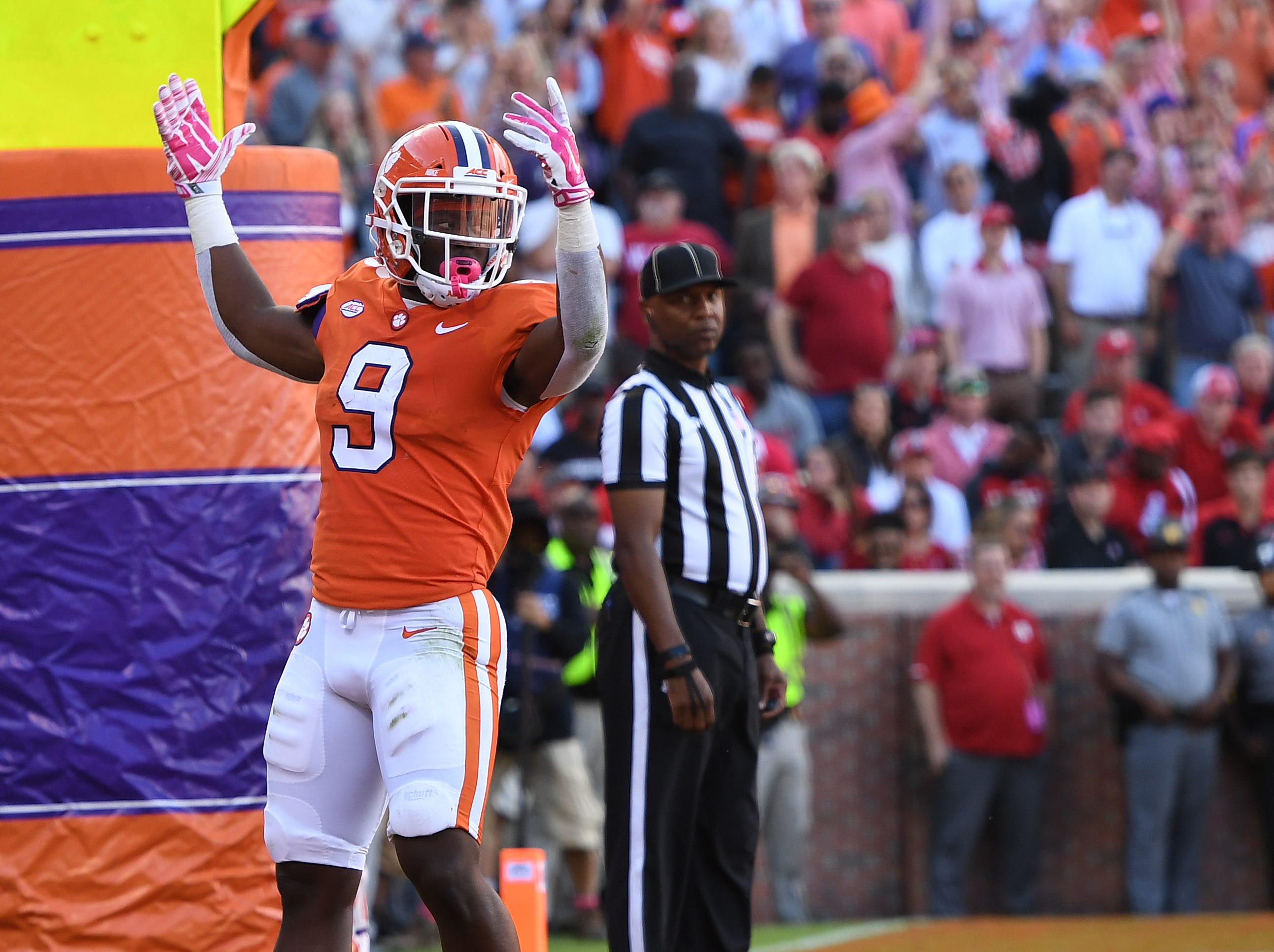 Clemson running back Travis Etienne (9) celebrates after scoring against NC State during the 2nd quarter Saturday, October 20, 2018 at Clemson's Memorial Stadium.