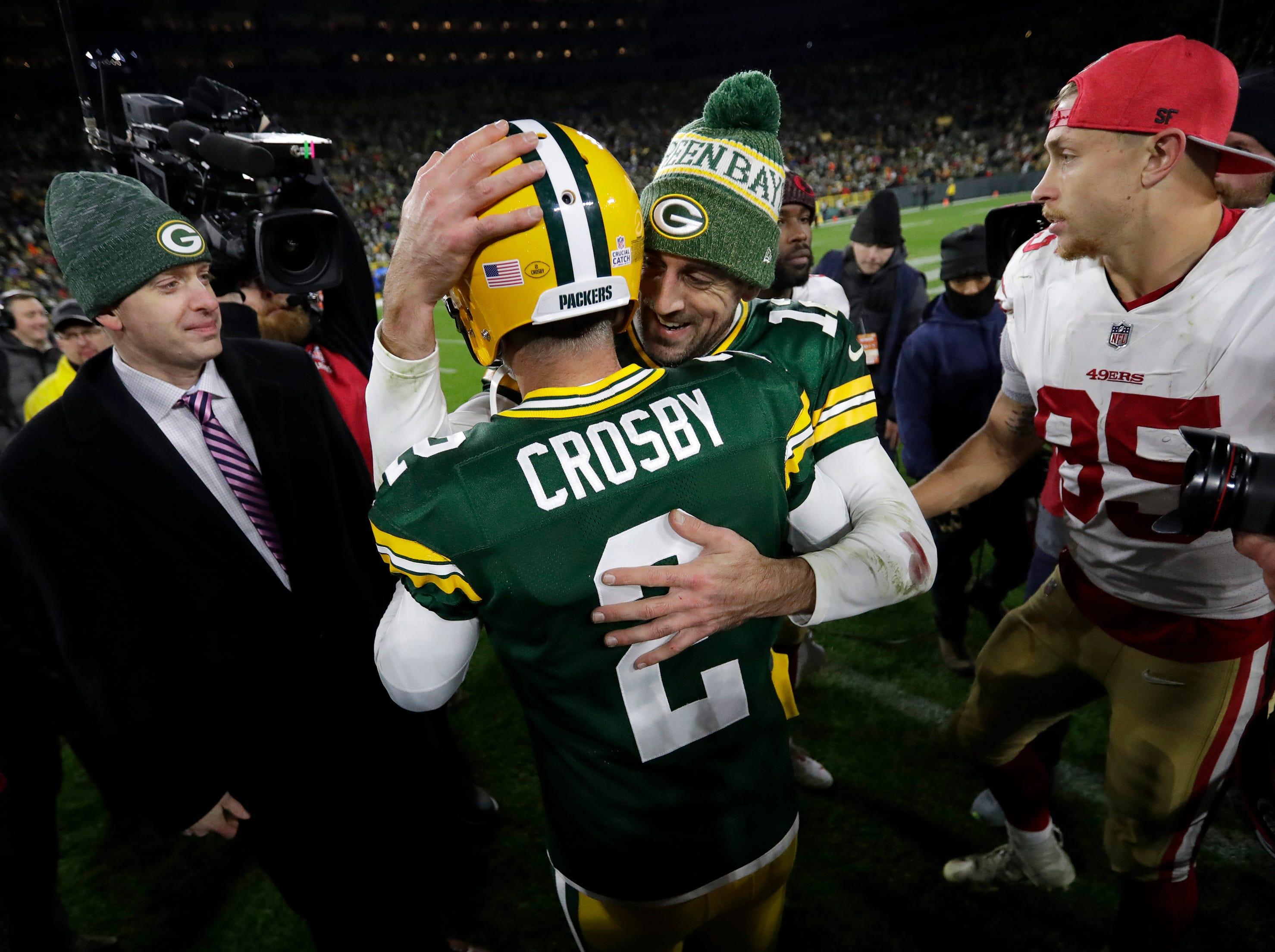 Green Bay Packers quarterback Aaron Rodgers (12) congratulates Mason Crosby (2) on his game-winning field goal against the San Francisco 49ers during their football game Monday, Oct. 15, 2018, at Lambeau Field in Green Bay, Wis. 