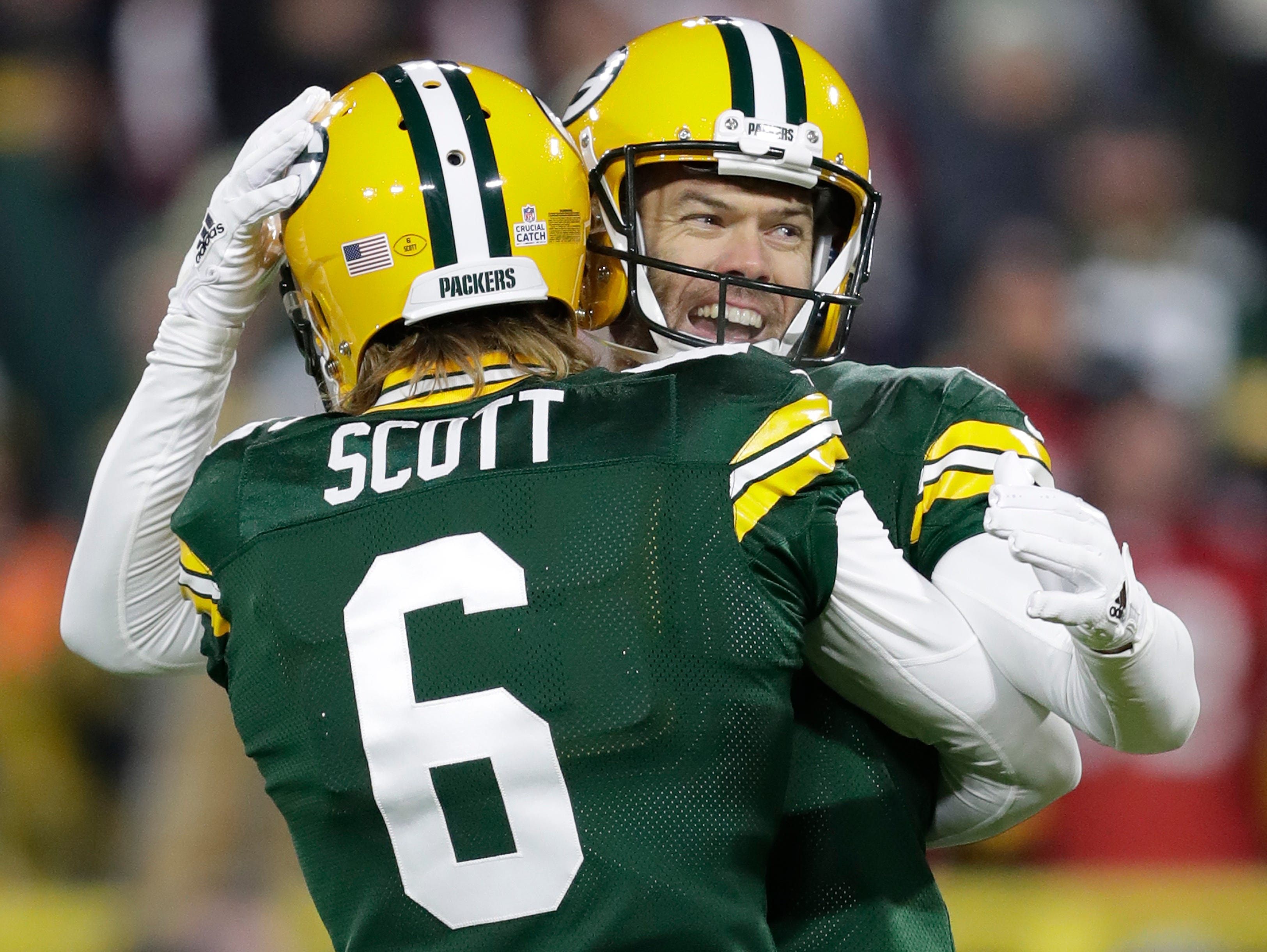 Green Bay Packers' Mason Crosby (2) celebrates his game-winning field goal with JK Scott (6) against the San Francisco 49ers during their football game Monday, Oct. 15, 2018, at Lambeau Field in Green Bay, Wis. 