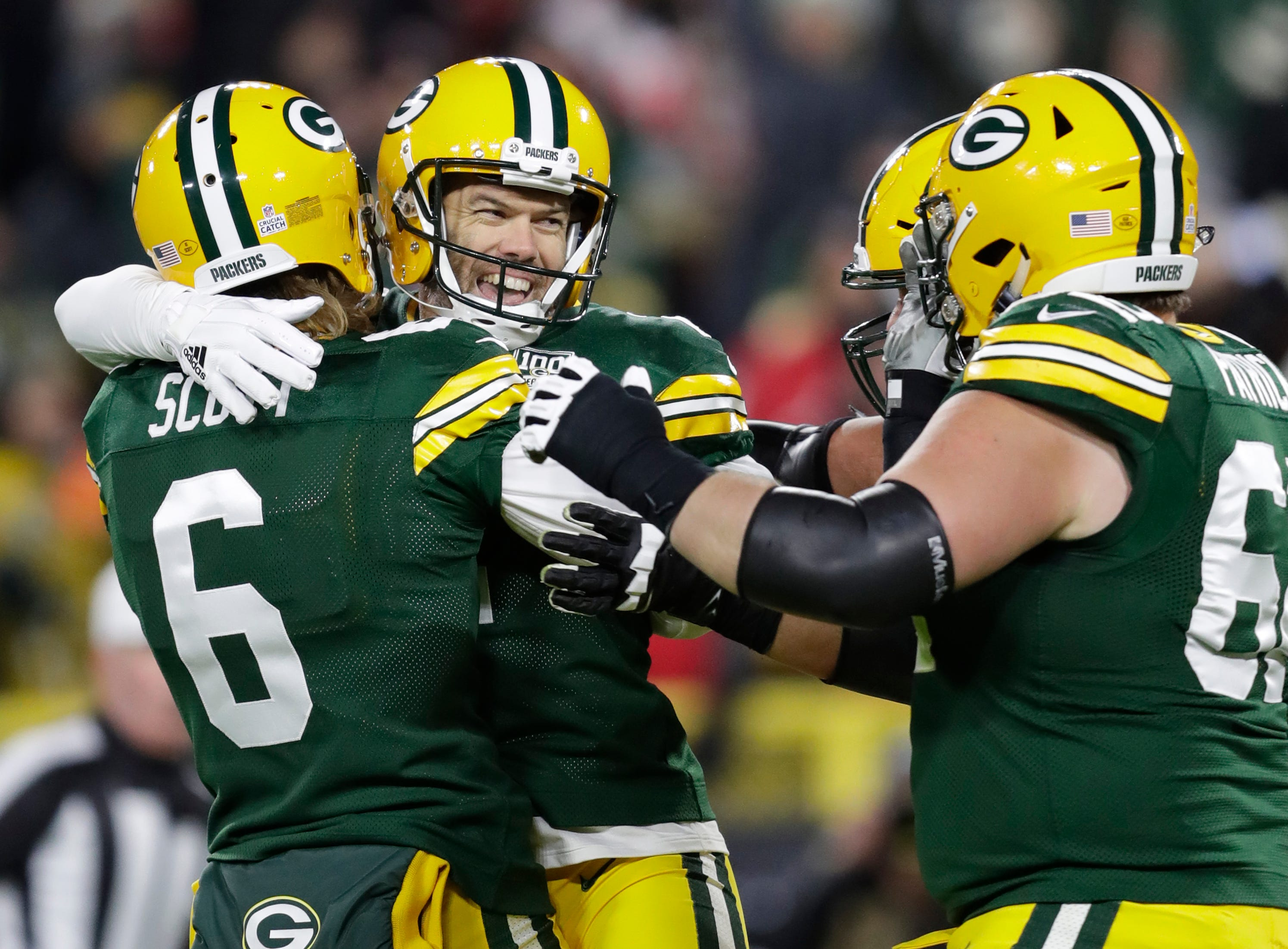 Green Bay Packers kicker Mason Crosby (2) is mobbed by teammates after kicking the game-winning fieldgoal against the San Francisco 49ers during their football game Monday, Oct. 15, 2018, at Lambeau Field in Green Bay, Wis. 