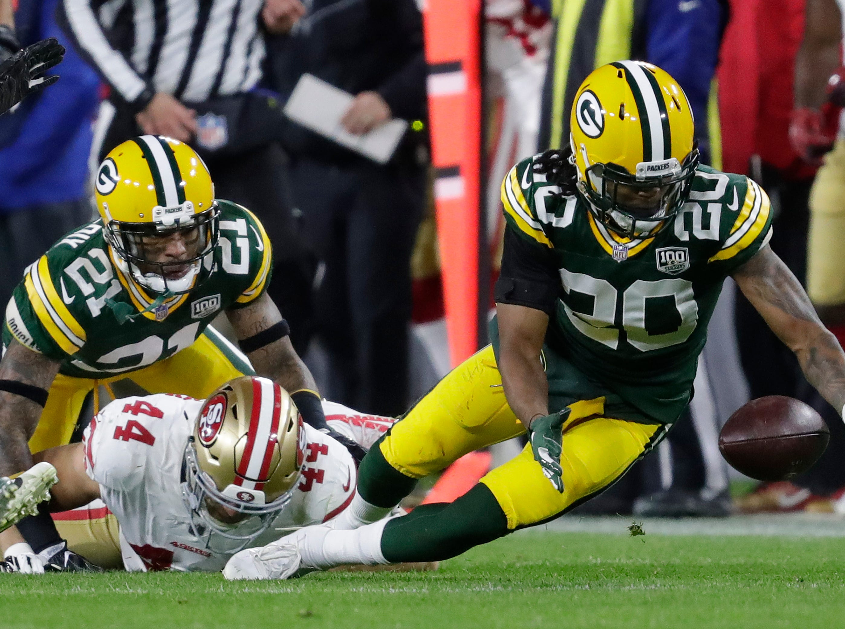 Green Bay Packers cornerback Kevin King (20) recovers a fumble by San Francisco 49ers running back Kyle Juszczyk (44) in the second quarter during their football game Monday, Oct. 15, 2018, at Lambeau Field in Green Bay, Wis. 