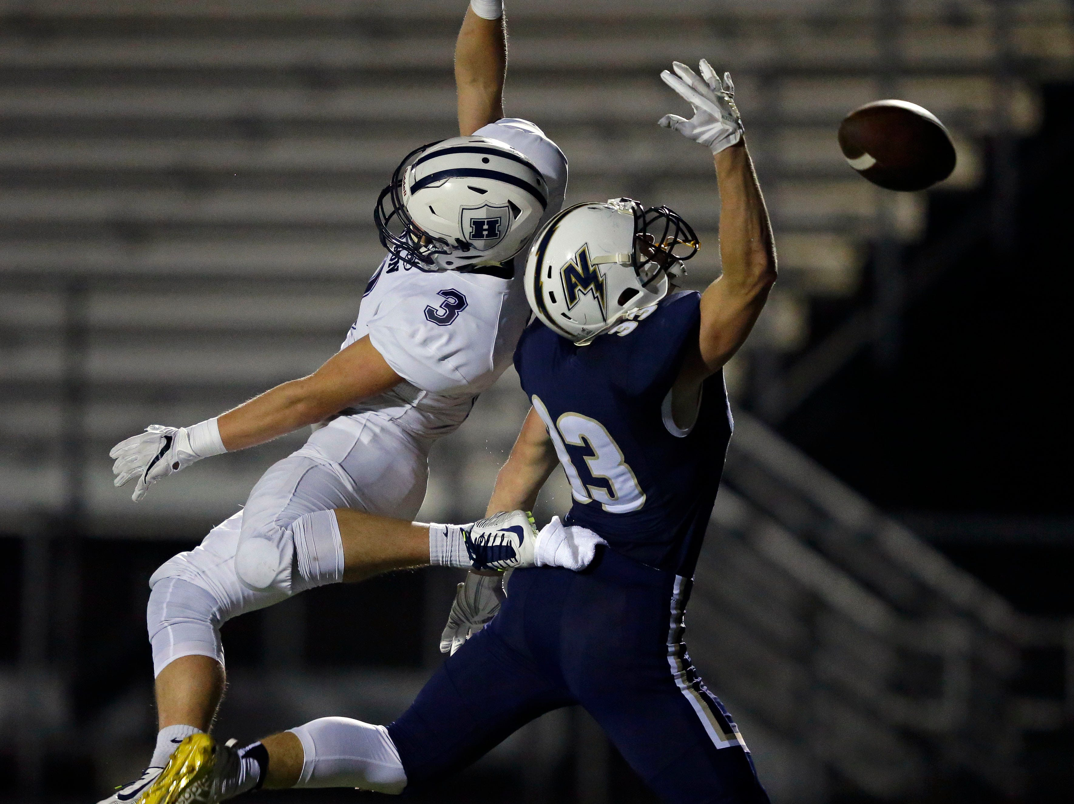 Neither Ben Karls of Hudson or Devin Blom of Appleton North come up with a catch in a WIAA Division 1 football playoff game Friday, October 19, 2018, at Paul Engen Field in Appleton, Wis.