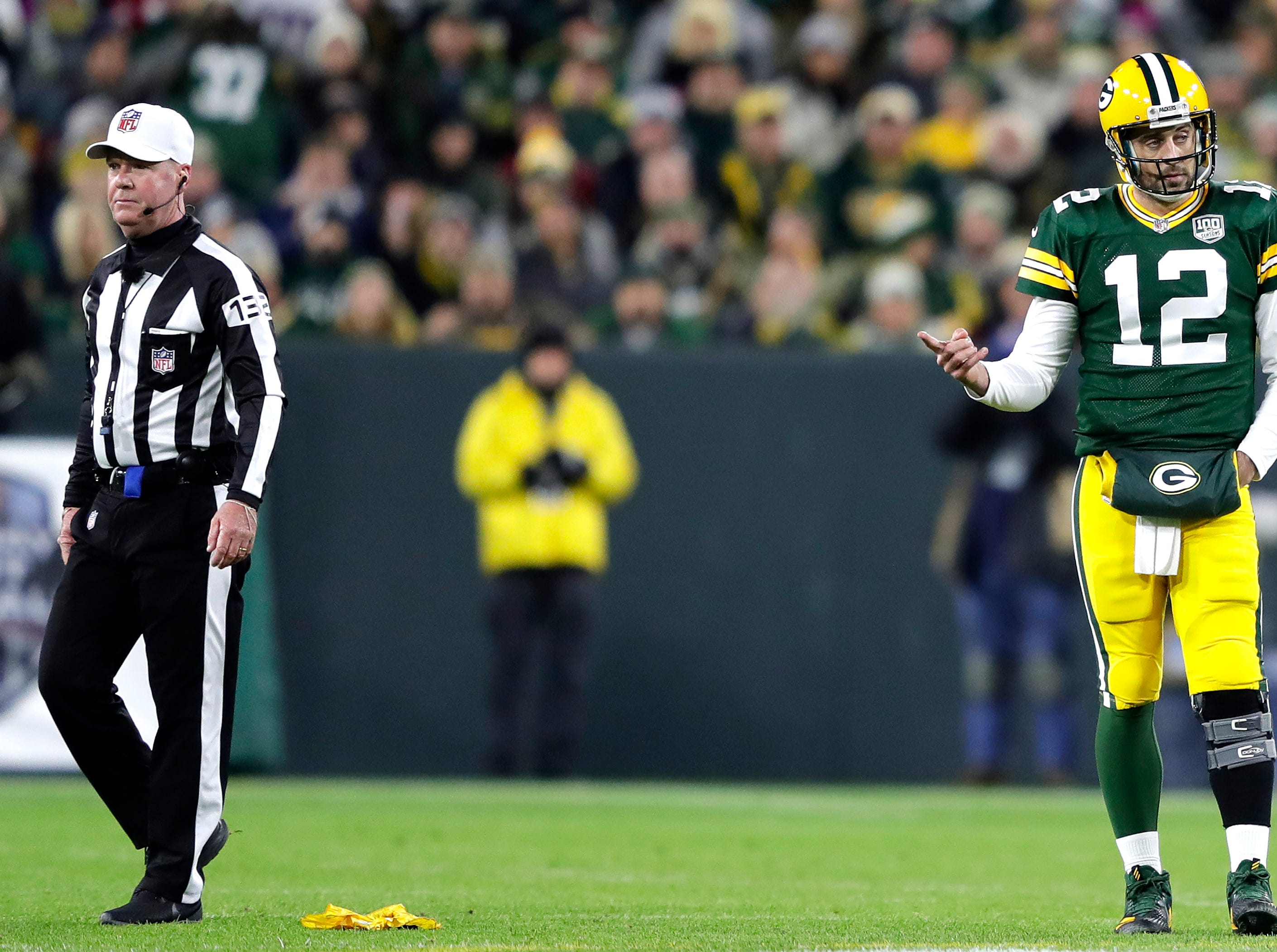 Green Bay Packers quarterback Aaron Rodgers argues a grounding call in the second quarter against the San Francisco 49ers on Monday, October 15, 2018, at Lambeau Field in Green Bay, Wis. 