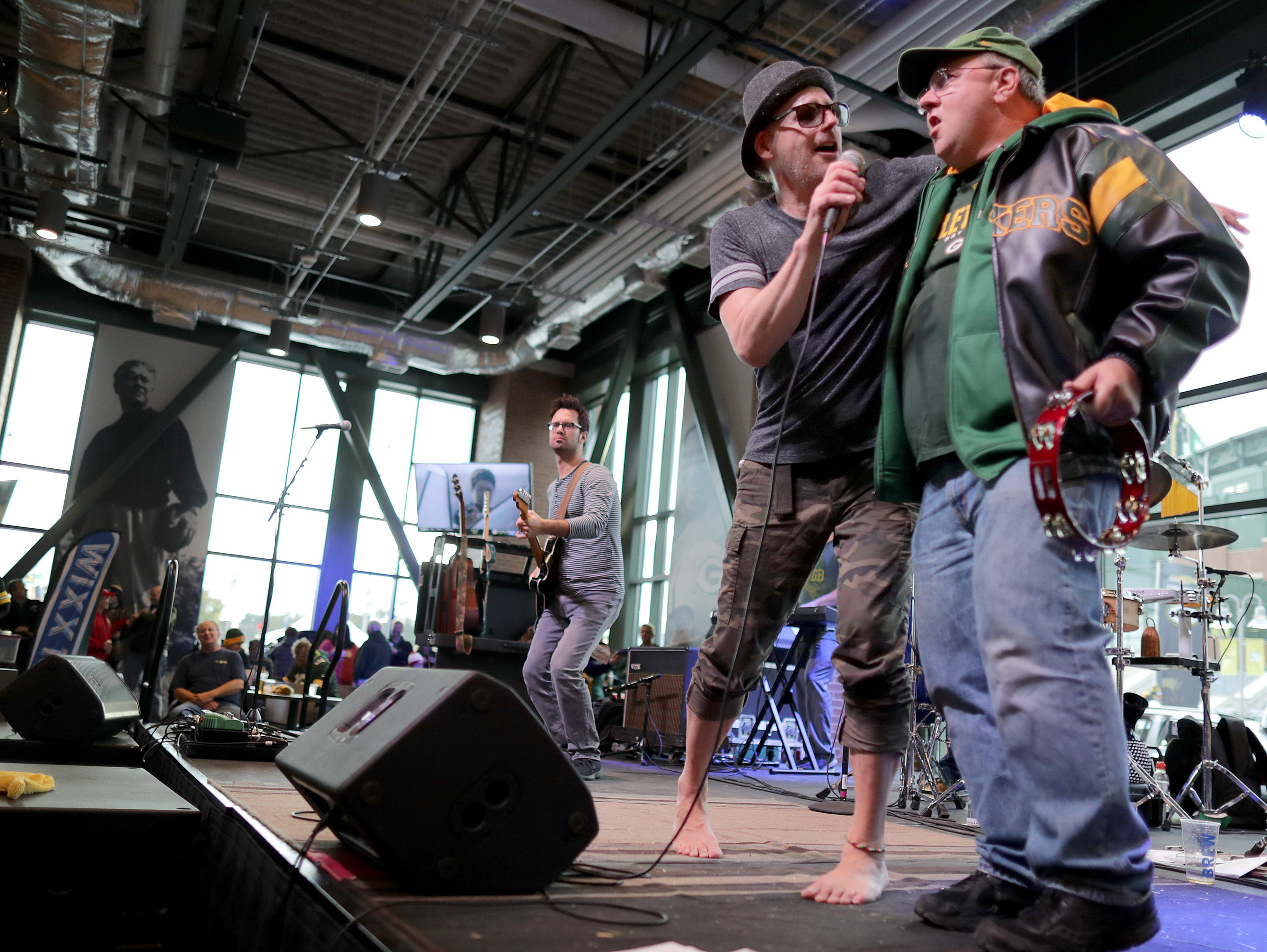 Love Monkeys lead singer John Hauser brings Packers fan Arland Wingate onstage while playing before the Green Bay Packers tkae on the San Francisco 49ers on Monday, October 15, 2018, at Lambeau Field in Green Bay, Wis. 