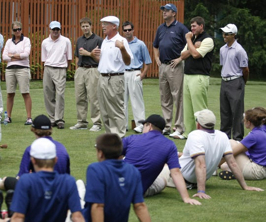 Wayne Warms, Manasquan, center, a teaching pro at Eagle Oaks Golf & Country Club in Farmingdale, speaks about technique to the golfers during the clinic in 2011.
