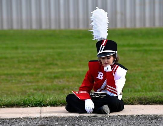 Baird High School senior Ashton Pate takes a moment for herself and her trumpet before her band's performance Monday at the Region 6 UIL marching band contest Monday at Wylie High School. Baird was the only Class 1A school to perform.