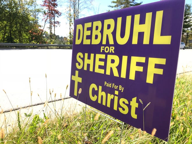 """Libertarian Sheriff's Office candidate Tracey DeBruhl has """"Paid for by Christ"""" on his election signs. A state government expert says TV, print and radio ads must have an accurate """"paid for"""" description, but the law does not address election signs."""
