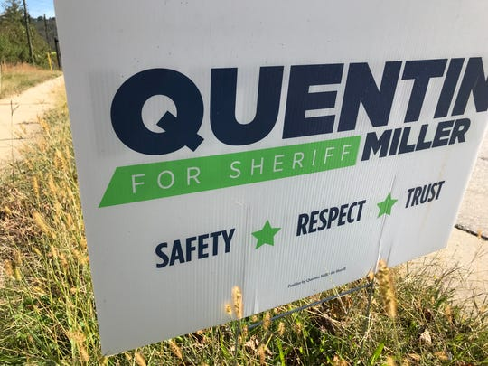 """Democratic Sheriff's Office candidate Quentin Miller has a traditional election sign, with """"Paid for by Quentin Miller for Sheriff"""" in small print at the bottom."""
