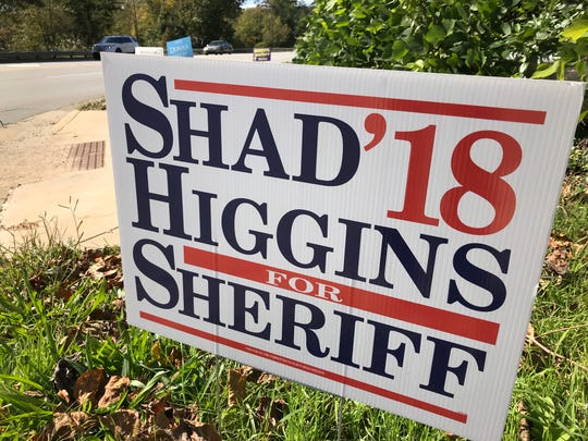 "Republican Sheriff's Office candidate Shad Higgins' signs are also traditional in their ""paid for"" markings. His signs say, ""Paid for by the Committee to Elect Shad Higgins."""