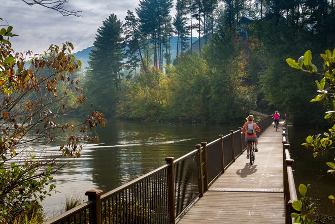 The true heart of the property, 62-acre Enka Lake serves as a stunning centerpiece that encourages residents to go outside and play all year long with opportunities for kayaking, fishing, swimming and camping available right on site.