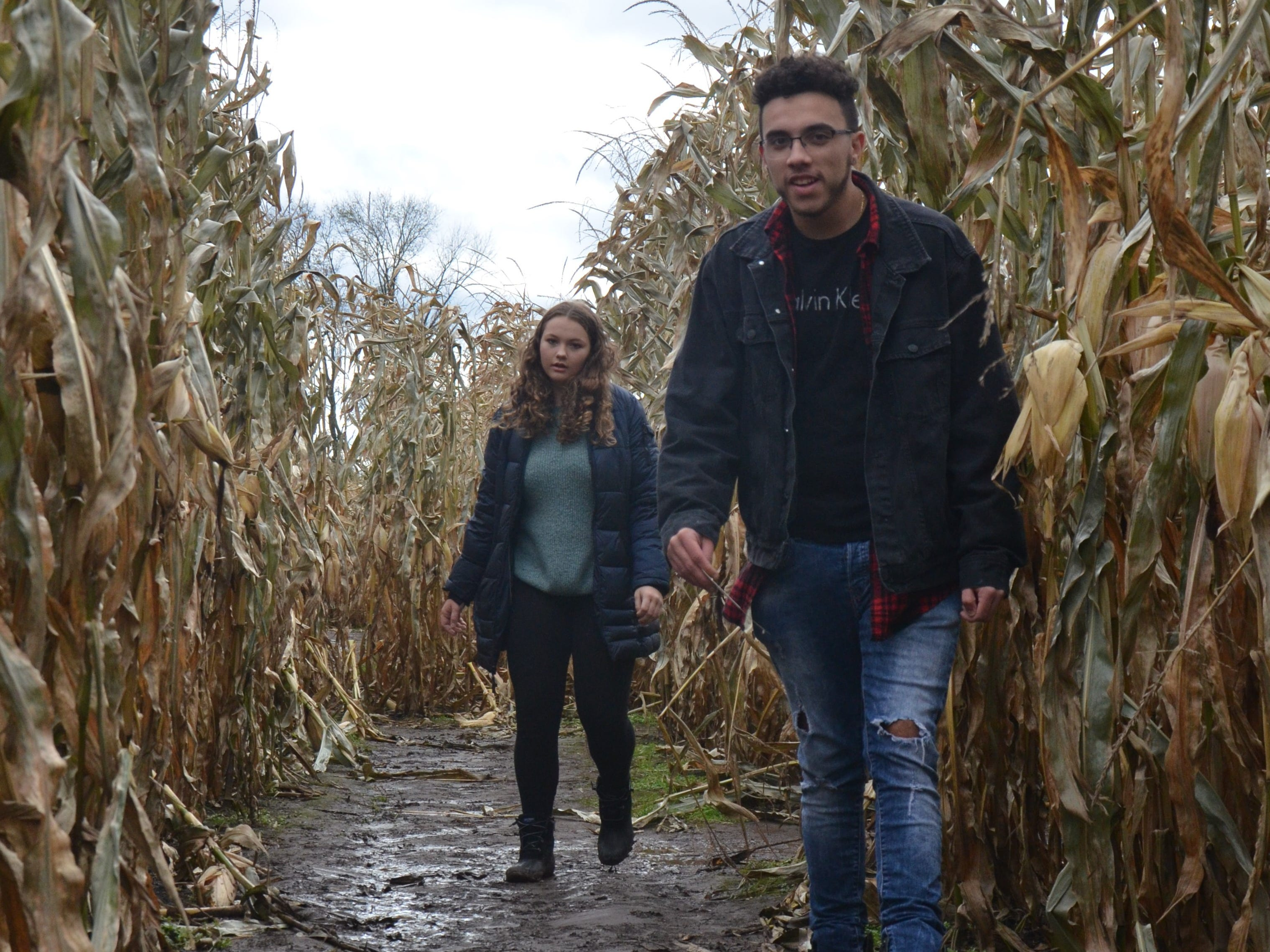 Jaylen Clark (right), 18, of Kalamazoo and Lindsey Peterson, 14, of Portage, finish the corn maze at Gull Meadow Farms in Richland on Sunday, October 21, 2018.