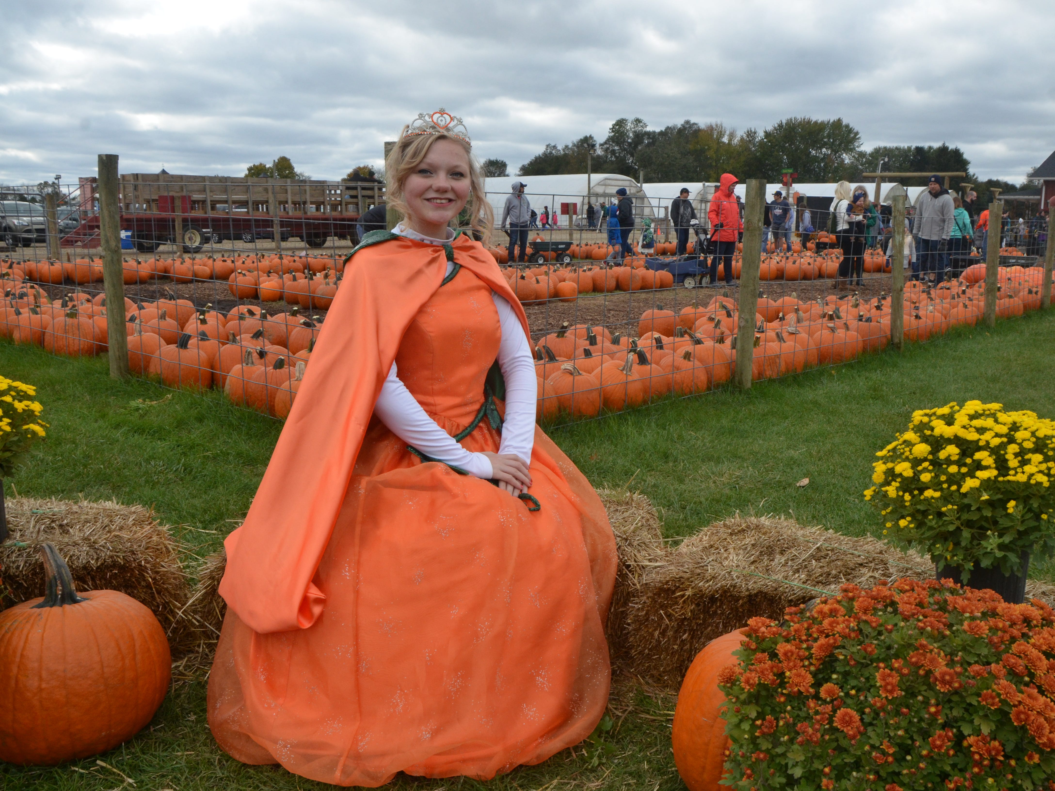 "Kaylee Hopwood, 19, of Kalamazoo, poses as the ""Pumpkin Princess"" at Gull Meadow Farms in Richland on Sunday, October 21, 2018."