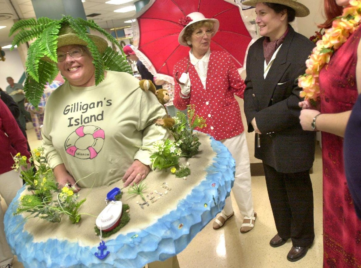 2004: Employees of the community relations department of United Health Services dress as the cast of Gilligan's Island on Friday at Binghamton General Hospital. Sandie Walker as the island (left to right), Linda Dean as Lovey Howell and Andrea Osterhout as Thurston Howell III.