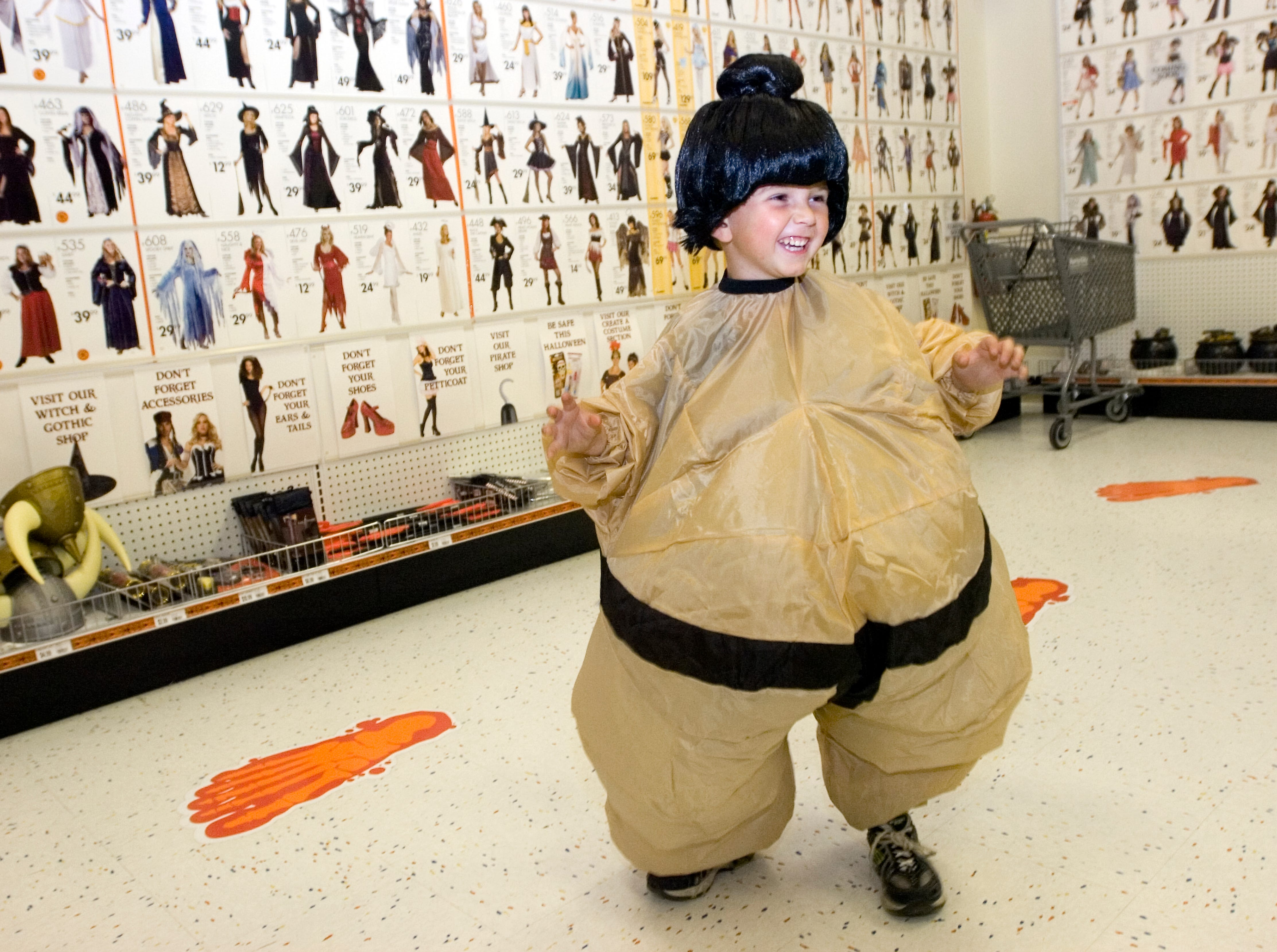2007: Four-year-old Justin Klym of Endwell strikes a wrestling pose as he tries on a Halloween costume Wednesday at Party City in Johnson City.