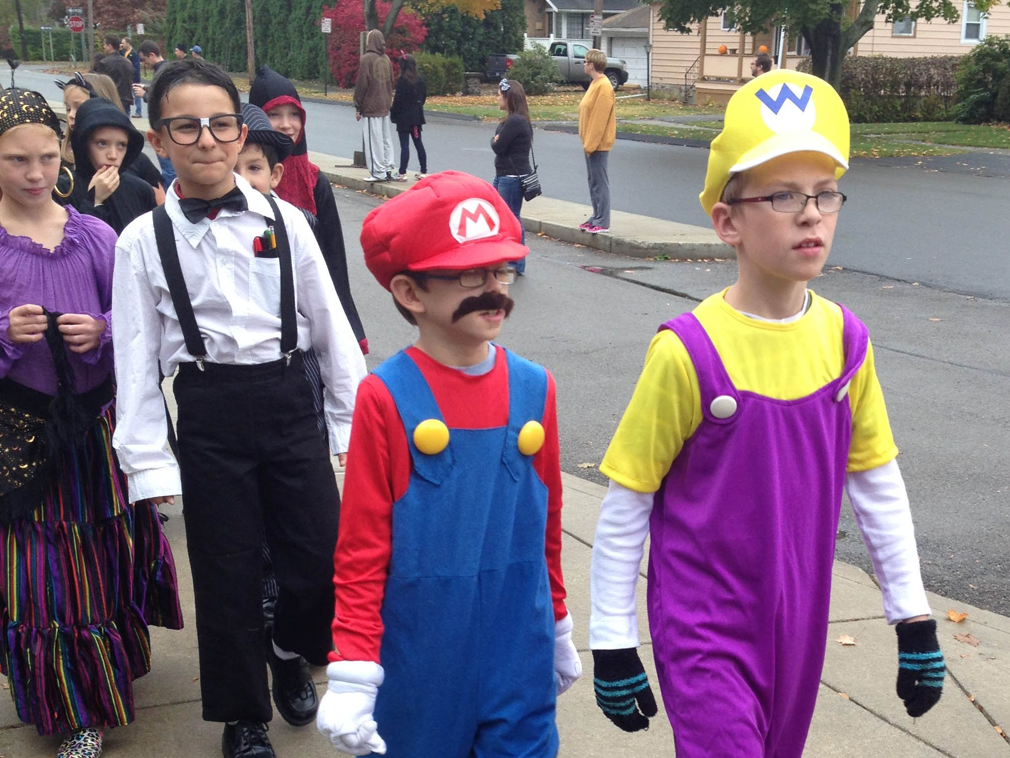 2013:  Halloween was celebrated in festive fashion on Thursday as eight elementary schools throughout the Elmira City School District conducted parades throughout the day. The parades are an annual event in the district. Here, Mario and Luigi take a stroll outside Hendy Elementary School in West Elmira.