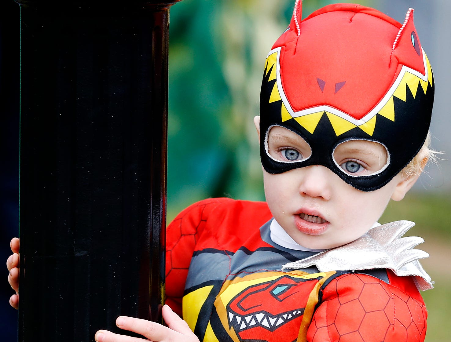 2015: A Power Ranger watches children run around while waiting in line for candy at Southport's Halloween Festival Saturday at Chapel Park.
